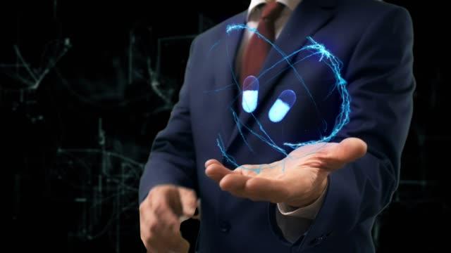 Hombre-de-negocios-muestra-holograma-concepto-3d-pastillas-en-la-mano