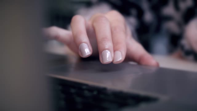 Female-is-Writing-and-Working-on-a-Laptop