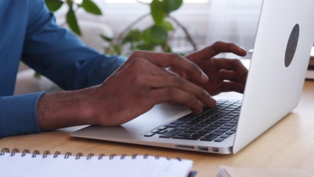 Businessman-typing-on-laptop