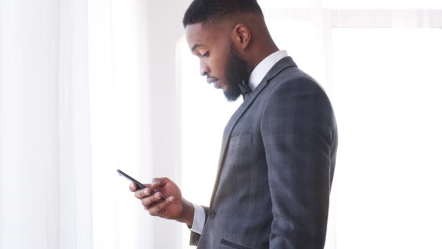 Businessman-text-messaging-on-mobile-phone