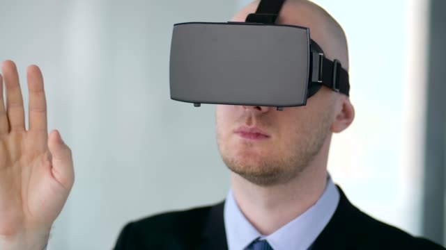 businessman-with-virtual-reality-headset-at-office