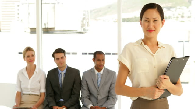 Businesswoman-giving-thumbs-to-camera