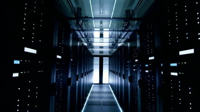 Descending-Camera-Shot-of-a-Working-Data-Center-Full-of-Server-Racks-
