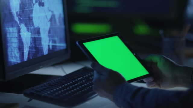 IT-Professional-is-Using-Tablet-with-Green-Screen-at-Work