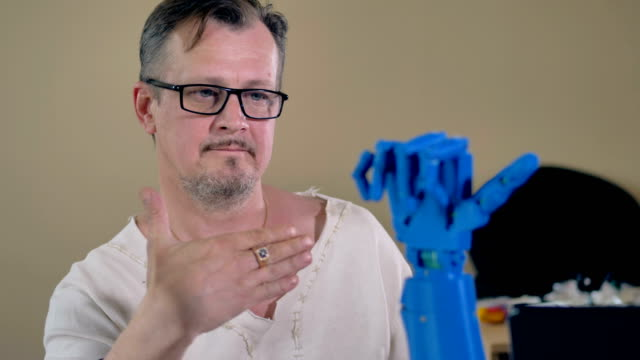 Close-up-of-the-bionic-hand-repeating-man-s-hand-movements-