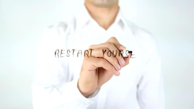 Restart-Yourself-Man-Writing-on-Glass