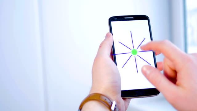 Man-using-futuristic-graphic-touchscreen-to-operate-smarthome-options-