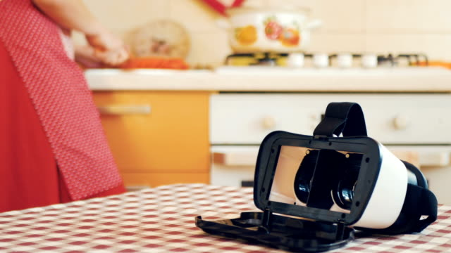 Hand-take-away-virtual-reality-glasses-from-table