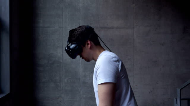 Man-Using-Virtual-Reality-Headset-with-Motion-Controllers