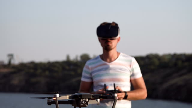 Man-in-VR-glasses-controlling-drone