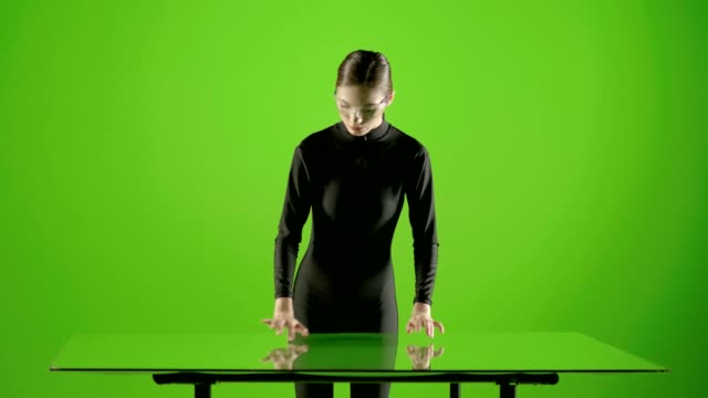 Attractive-girl-young-fashion-model-virtual-touch-screen-gesture-shot-in-green-screen-studio-Interactive-futuristic-gesture-Medium-shot-Prores-shoot-on-Blackmagic-Ursa-Mini-Pro