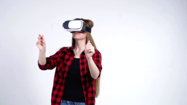 The-Young-Girl-in-the-Virtual-Reality-Helmet-is-Actively-Playing-the-Game