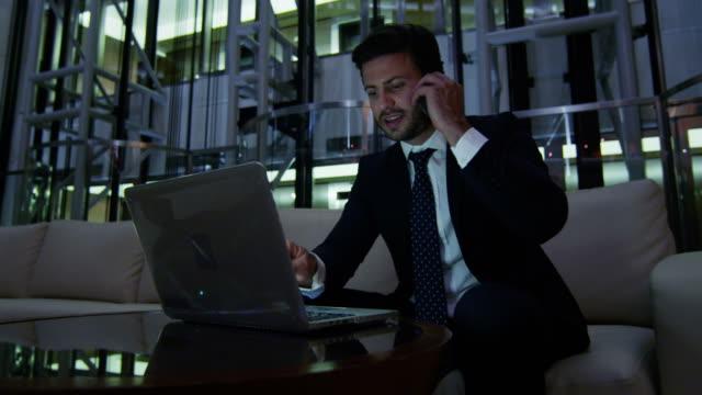 Arabic-businessman-night-office-technology-laptop-smart-phone