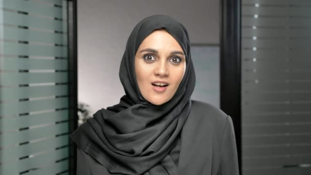 A-young-Arab-girl-in-a-hijab-is-surprised-indignant-and-looks-at-the-camera-60-fps
