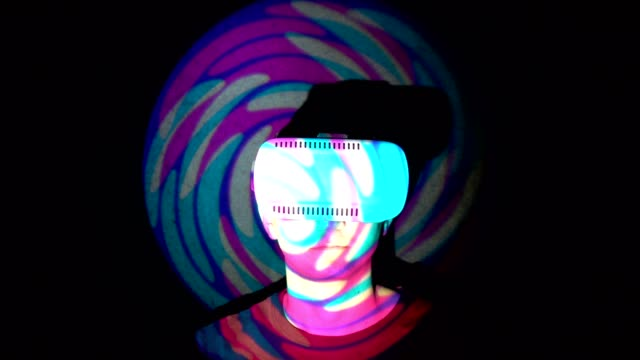 Caucasian-man-experiencing-virtual-reality-playing-video-games-using-vr-headset