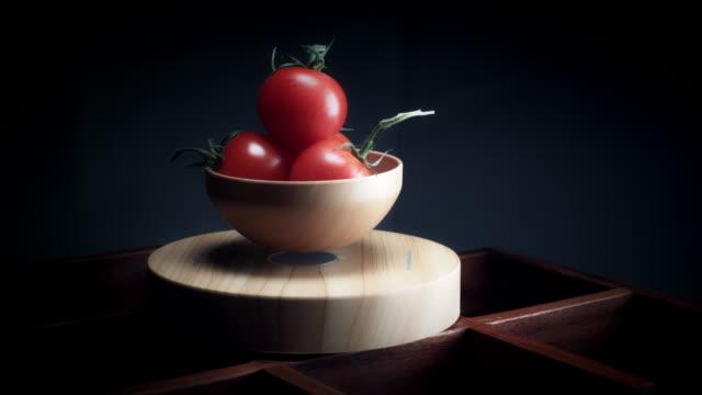4K-Abstract-Levitation-Platform-with-Tomato-on-Black-Background