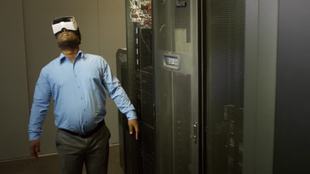 African-Businessman-Using-VR-Goggles