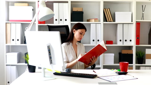 businesswoman-in-white-blouse-examining-documents-in-folder