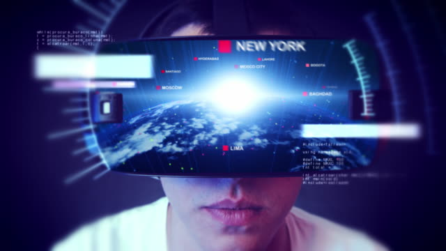 Handsome-young-man-wearing-VR-headset-and-experiencing-virtual-reality-