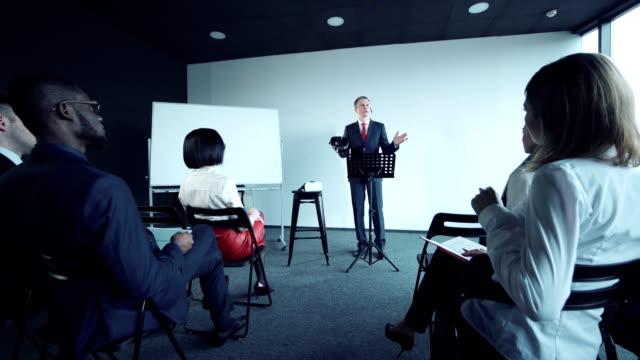 Businessman-doing-presentation-of-vr-helmet