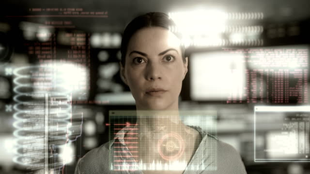 Woman-analyzing-data-in-a-high-tech-workplace-