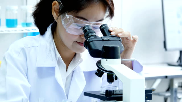 Female-Scientist-using-microscope-for-work-Scientist-working-at-laboratory-People-with-medical-science-doctor-healthcare-concept-4K-Resolution-