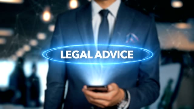 Businessman-With-Mobile-Phone-Opens-Hologram-HUD-Interface-and-Touches-Word---LEGAL-ADVICE