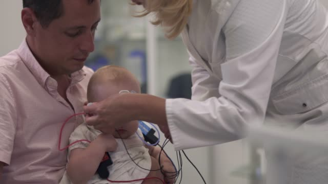 Loving-father-holds-his-little-daughter-in-arms-in-the-hospital