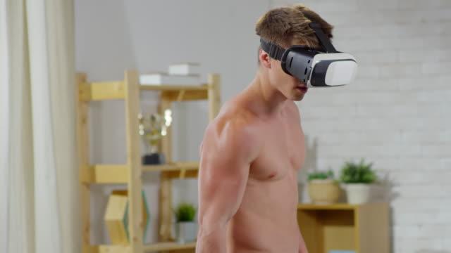 Man-in-VR-Glasses-Using-Dumbbell