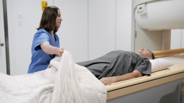 Doctor-And-Patient-In-MRI-Lab-At-Medical-Center