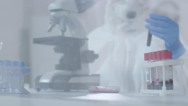 Unrecognizable-Medical-Scientist-Working-in-Laboratory