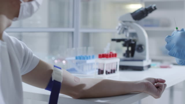 Unrecognizable-Doctor-Taking-Blood-Sample-from-Sick-Patient