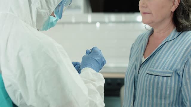 Laboratory-worker-taking-pcr-test-putting-sample-swab-in-tube-coronavirus