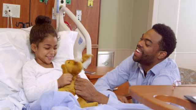 Father-And-Child-Play-With-Soft-Toy-In-Hospital-Shot-On-R3D