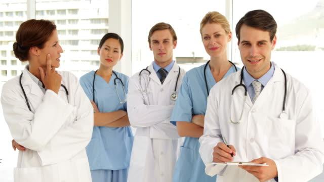 Medical-team-looking-at-camera