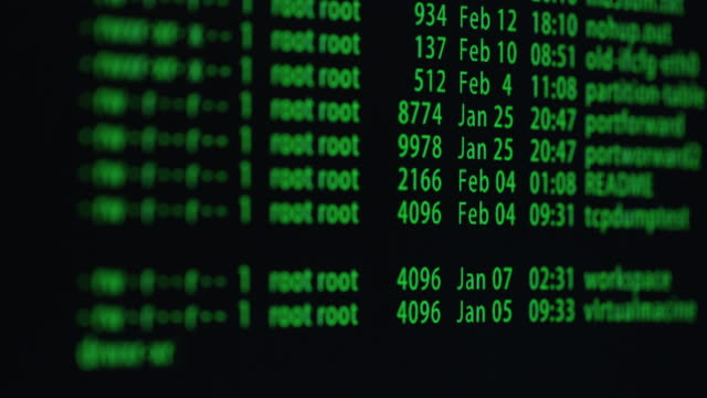 Footage-of-computer-display-screen-with-green-moving-text-with-code-in-the-terminal-software-