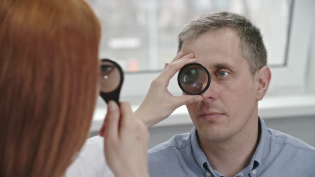 Optometrist-Checking-Patient's-Eyes