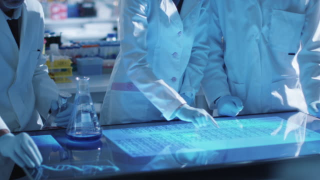 Team-of-scientists-are-working-on-a-digital-touch-screen-in-a-laboratory-