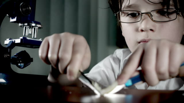 4k-Biology-Student-Child-with-Microscope-Preparing-for-Test