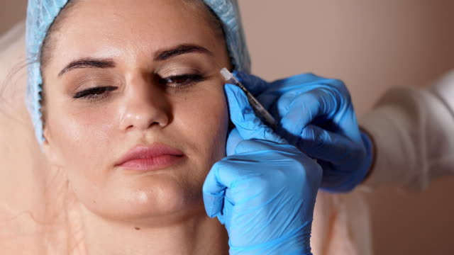 Facial-injection-Female-patient-and-doctor-with-syringe-of-botox