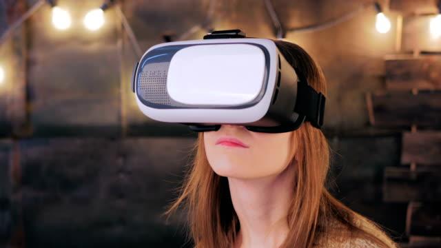 Young-woman-using-Virtual-Reality-Glasses
