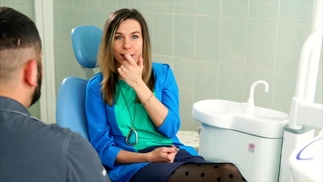 Female-patient-in-dentist-chair-having-consultation-with-dentist-