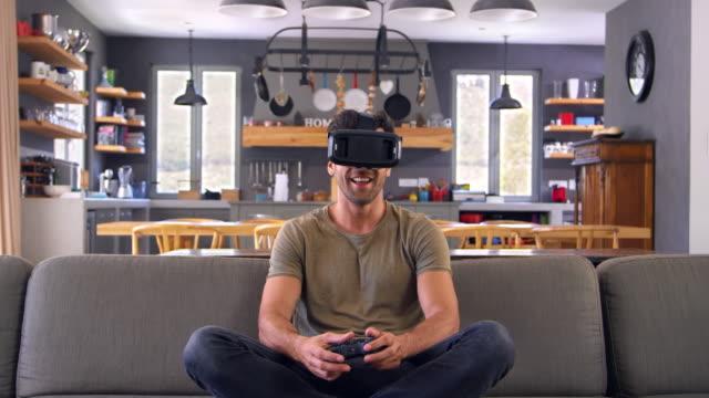 Man-Playing-Computer-Game-Wearing-Virtual-Reality-Headset