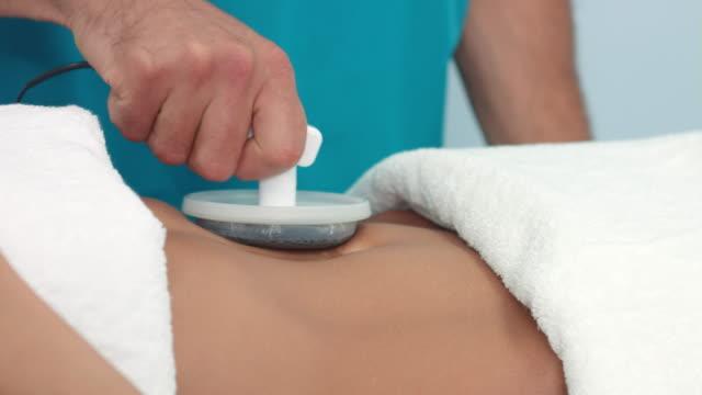 Electrostatic-belly-massage-in-spa-center