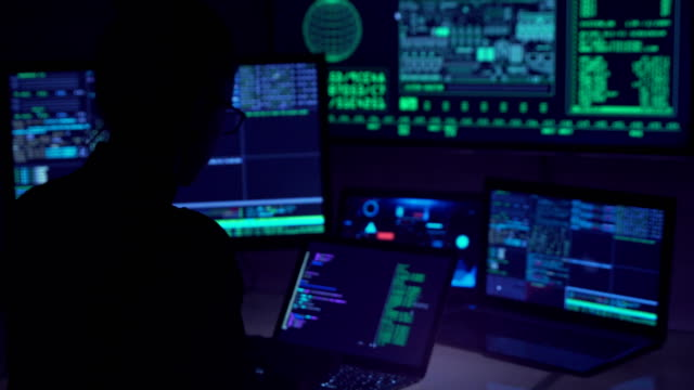 Hacker-coding-in-cyberspace-typing-on-laptop-Highly-skilled-computer-expert-