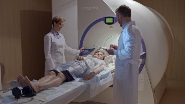 Medical-Technicians-Preparing-Patient-for-MRI-Scan