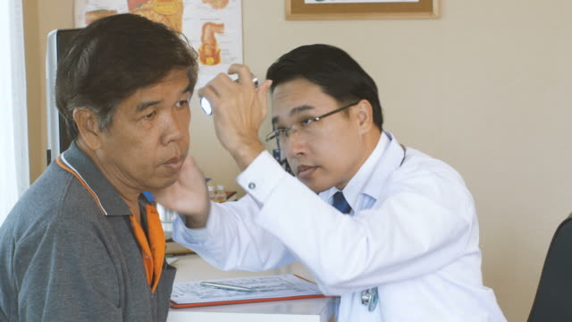Doctor-is-diagnosing-the-patient-s-ears-and-eyes