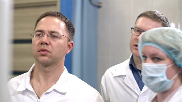 Two-male-doctors-and-a-nurse-managing-surgery