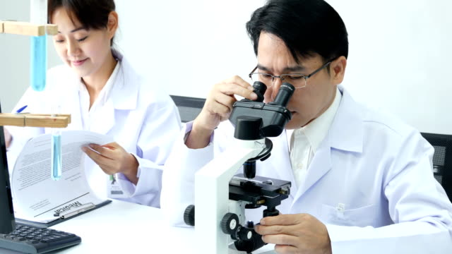 Asian-Scientist-use-microscope-for-work-at-laboratory-People-with-medical-science-doctor-healthcare-concept-4K-Resolution-