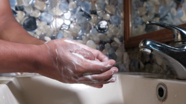 Washing-hands-rubbing-with-soap-man-for-corona-virus-prevention